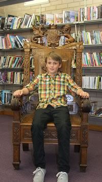 Ten year old Ivor Roberts from Cardiff sits in the chair made by his great, great, great grandfather for the National Eisteddfod of Wrexham in 1876.