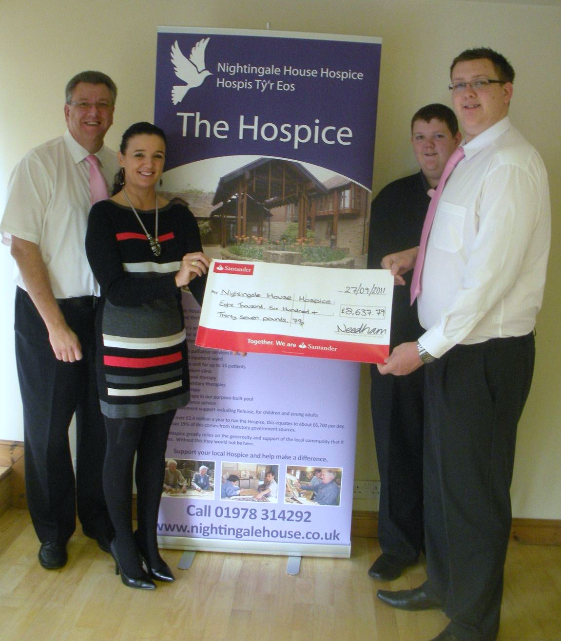 The Needham family present a cheque for £8,638 to Rachael Jones, Corporate Fundraiser at Nightingale House Hospice.