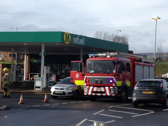 Fire and police services attend the petrol leak at Morrisons in Wrexham