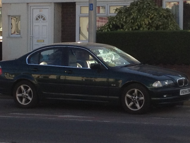 A BMW was left with damage to the front windscreen and the entire rear window smashed.