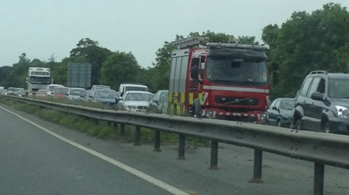a483 crash fire crews 500x279 A483 Southbound Nr Rhostyllen Closed After Car Hits Back Of Lorry
