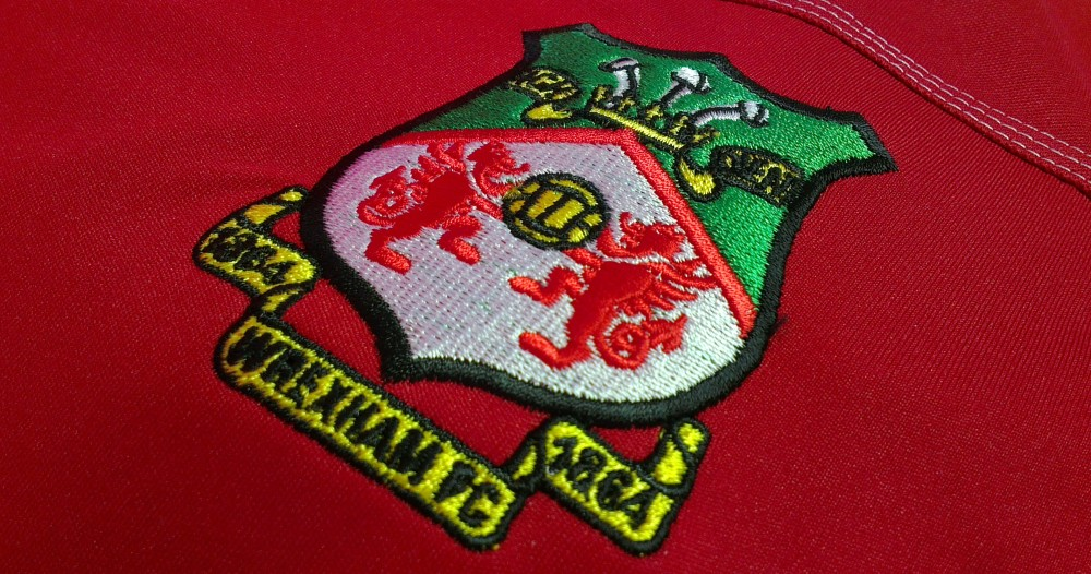 Detail of the new embroidered badge with new foundation date.