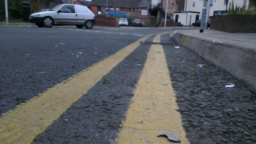 Broken baubles with sharp edges in the road - some appeared to be run over or stamped on.
