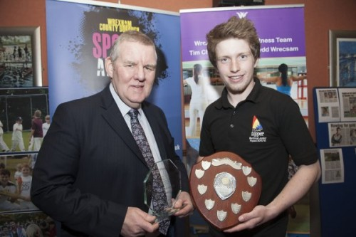 Wrexham County Borough Council Sports Awards at Brymbo Sports and Social Complex. Pictured is Aled Goddard receiving the Junior sports personality of the year award from Mac Kenderick of Brymbo sports club.
