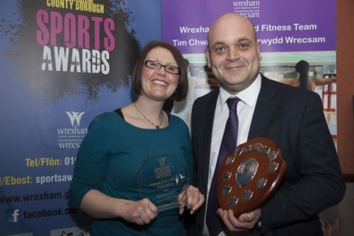 Wrexham County Borough Council Sports Awards at Brymbo Sports and Social Complex. Pictured is Simon Ellis Head teacher Maelor school Penley receiving the Secondry school of the year award from Lyndsey Evans of Lakeside Coaches.