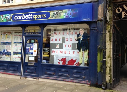 The odd shop has adjusted window displays to show support for the Reds!