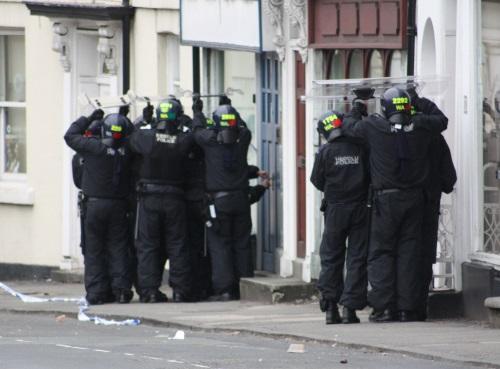 police-enter-building