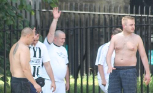Fans enjoying sun & beer outside St Giles, hopefully just waving.