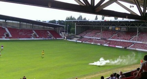 When Wrexham played Tranmere in a friendly a smoke bomb was thrown on the pitch by Tranmere fans.