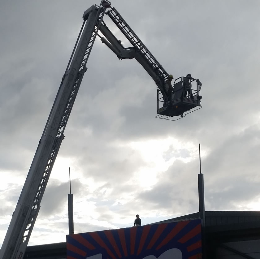 Fire Crews Rescue Two People From Discount Store Roof